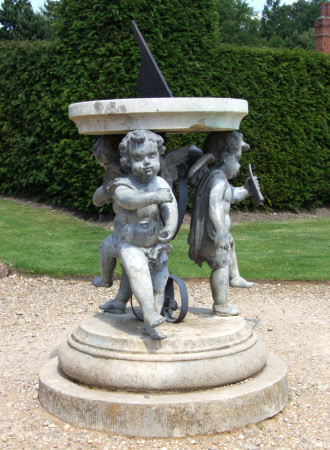 Sundial supported by three cherubs