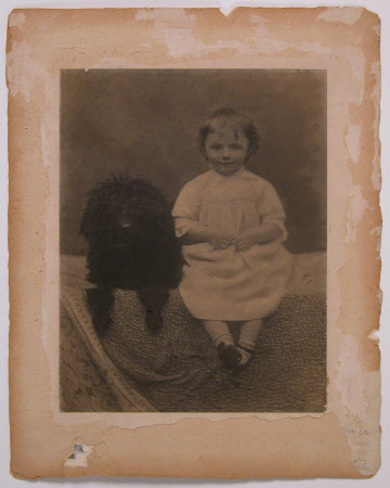 Clementine Ogilvy Hozier, later Baroness Spencer-Churchill (1885-1977) aged 3 or 4 with a dog