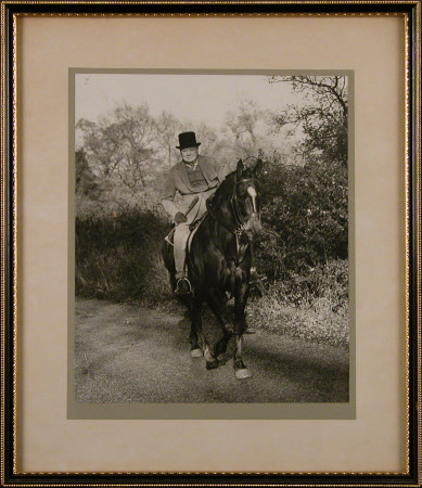 Sir Winston Churchill (1864-1975) riding wearing a top hat
