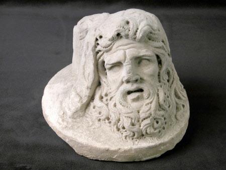 Head of Goliath on plinth