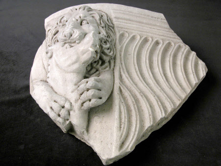 Fragment of strigillated sarcophagus showing a lion eating a horse