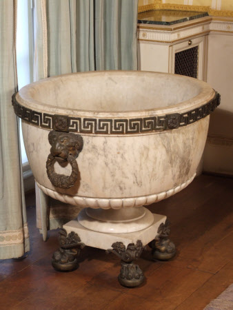 Oval Regency cistern with gadrooned body, the gilt-bronze rim with Greek key-pattern and foliate ...