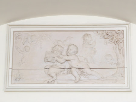 Sporting putti and an infant satyr