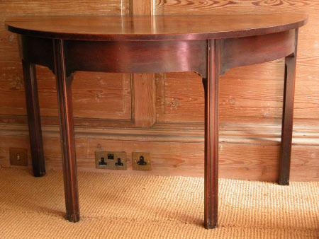 Semi-circular mahogany side table