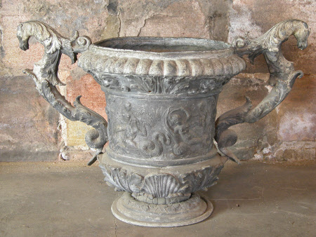 Lead urn, one of a pair, with two large scrolling handles terminating with animal heads