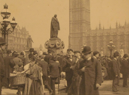 Crowd at statue of Benjamin Disraeli, 1st Earl of Beaconsfield (1804-1881) by Maria Razzi, ...