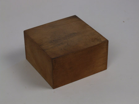 A pine block support for a metal sculpture -  No.112419