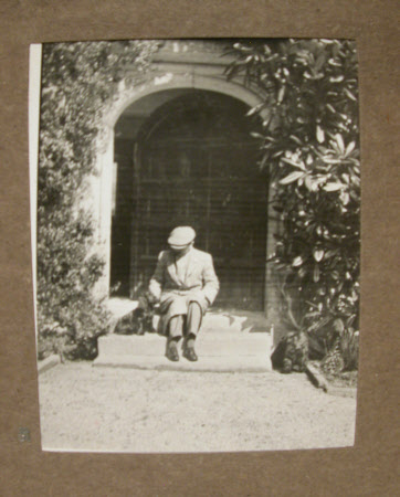 The Hon. Cecil Edward Agar-Robartes (1892-1939) seated on the steps of Lanhydrock House, Cornwall