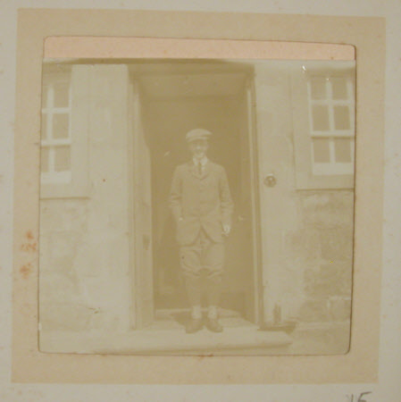 The Hon. Francis Gerald Agar-Robartes, 7th Viscount Clifden (1883-1966) on steps inside the door of ...