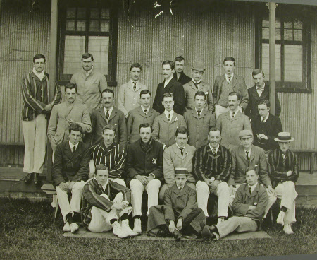 Group of 25 young men outside sports pavilion including Captain, The Hon.Thomas Charles Reginald ...