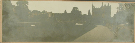 Panoramic view of the garden, house and gatehouse at Lanhydrock from below the coachhouse
