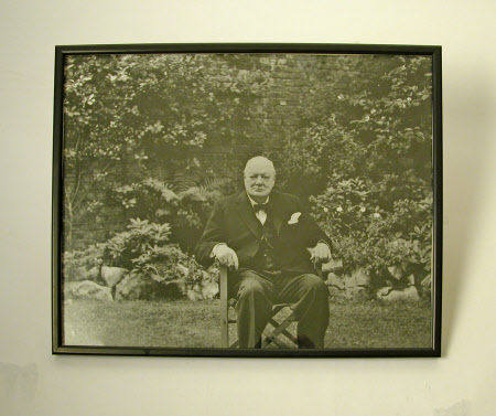 Sir Winston Churchill (1864-1975) seated in the garden at Hyde Park Gate