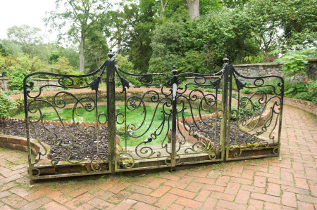 Wrought iron scrollwork screen with lillies