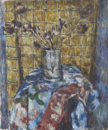 A Vase of Flowers on a Floral Tablecloth against a Yellow-tiled Wall