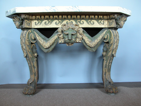 A pair of carved, painted and parcel-gilt side or console tables, English, in the manner of William ...