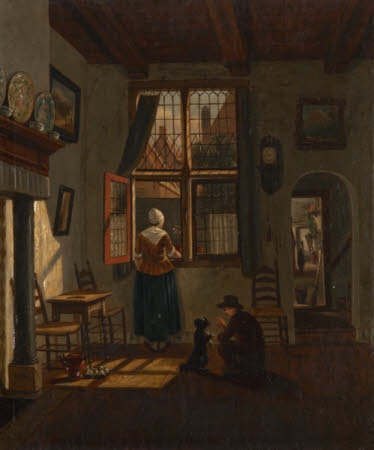 A Dutch Interior with a Woman looking out of a Window and a Boy training a Dog to sit