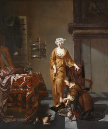 A Lady in an Interior with a Servant washing her Foot