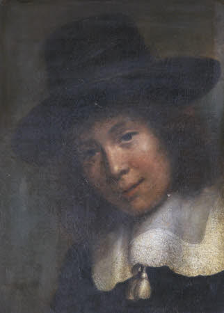 A Young Man in a Black Hat and White Lace Collar with Tassels