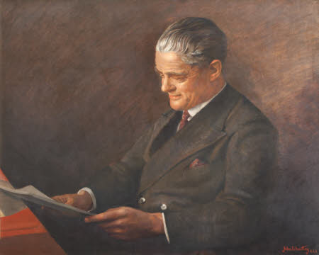 William Richard Morris, 1st Viscount Nuffield (1877-1963) in a Brown Suit reading a Book