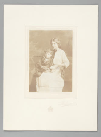 Young woman and boy in sailor suit