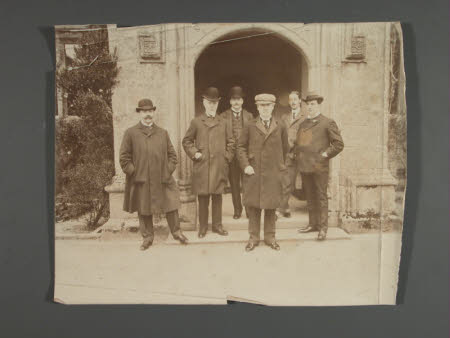 Group of men standing at the entrance to Lanhydrock House, Cornwall, including Thomas Charles ...