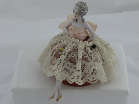 Pin cushion doll