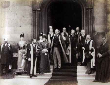 Baron Peckover on the steps of Bank House