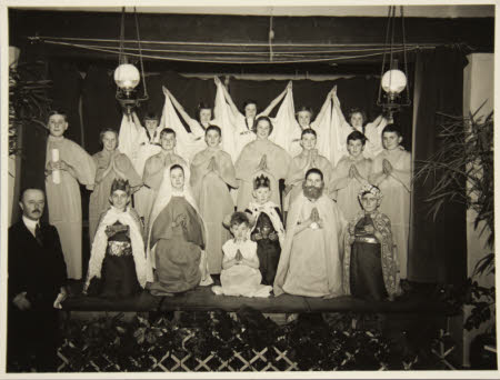 Boys and  girls, evacuees, on a stage taking their bow at the end of a  nativity play with The Hon. ...