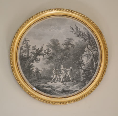 Four men fighting in a wood