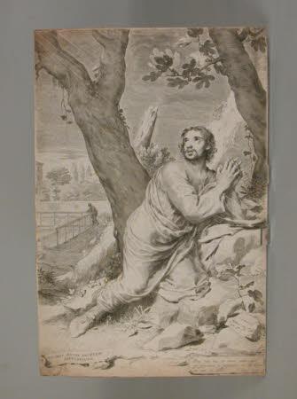 Saint Augustine Bishop of Hippo (354-430 AD) kneeling on rocks praying