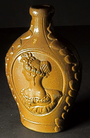 Brown stoneware cordial bottle with portrait of Queen Victoria (1819-1901)