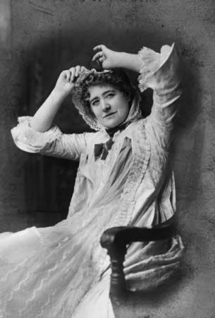 Ellen Terry (1847-1928) as Nance Oldfield sitting in a chair in 'Nance Oldfield' by Charles Reade.