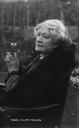 Dame Ellen Terry (1847-1928) seated in a garden