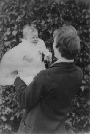 Edward Gordon Craig (1872 - 1966) holding Rosemary Nella (daughter) as a baby