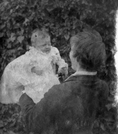 Edward Gordon Craig (1872-1966) holding his baby daughter Rosemary Nell Craig later, Mrs Robert ...
