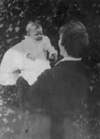 Edward Gordon Craig (1872-1966) holding his baby daughter Rosemary Nell Craig later Mrs Robert ...