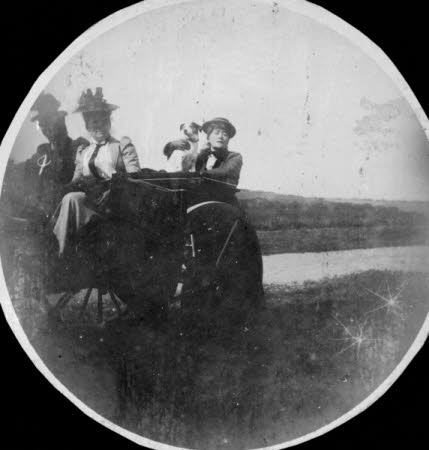 Ellen Terry (1847-1928) holding her dog 'Fussie' with two other unknown females in a coster cart at ...