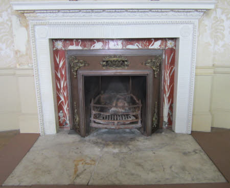 Chimneypiece, two floral motifs, with egg and dart border inset with white swans, reeds and ...