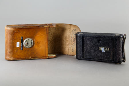 A No.1 Autographic Kodak Junior Model A folding roll-film camera and brown leather case.