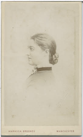 Monochrome bust of young woman in profile.