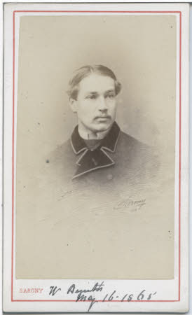 A portrait of a young man in a formal jacket.