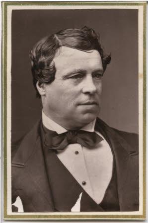 Half length portrait of gentleman in winged collar shirt