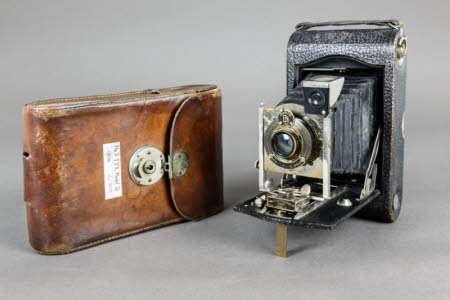 No.3 Autographic Kodak model G folding rollfilm camera with brown leather case.