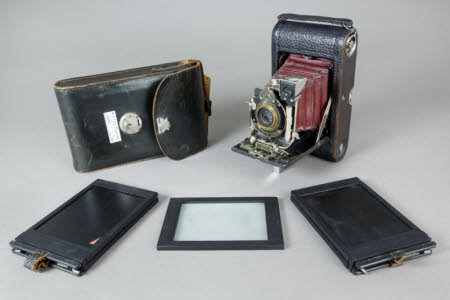 A No 3 folding pocket camera in a leather case.