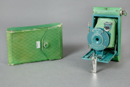 A Kodak Petite folding rollfilm camera in green with original green matching case.