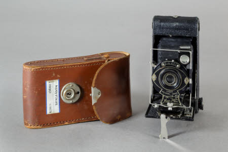 May Fair folding rollfilm camera by Houghton-Butcher with brown leather case.