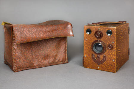 Box camera in brown leatherette case.