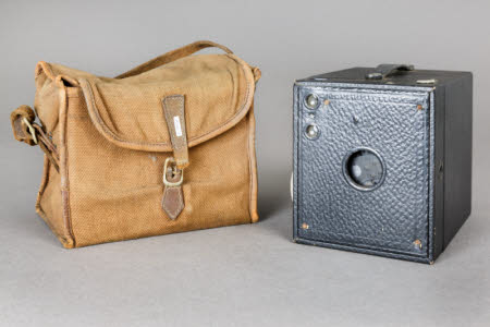 A Kodak No 3 Brownie rollfilm camera in  a canvas case.