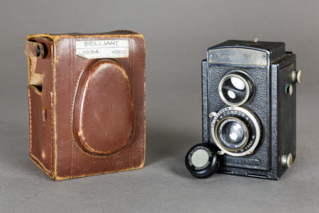 Brilliant Twin Lens Reflex camera with fitted leather camera case.