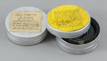 Two Kodak Pathé film tins, one containing film.